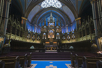 Located in the historic district of Old Montreal, The church's Gothic Revival architecture is among the most dramatic in the world; its interior is grand and colourful, its ceiling is coloured deep blue and decorated with golden stars, and the rest of the sanctuary is a polychrome of blues, azures, reds, purples, silver, and gold.